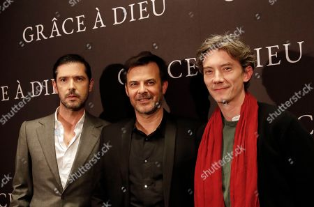 """Actor Melvil Poupaud, left, director Francois Ozon, center, and actor Swann Arlaud pose before the premiere of the film """"Grace a Dieu"""" (""""By the Grace of God"""") in Paris, . A French judge has refused to block the release this week in French cinemas of a movie based on a Catholic sex scandal"""