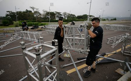 """Workers build the stage for an upcoming concert coined: """"Concert for the freedom of Venezuela"""" on the Colombian side of the Tienditas International Bridge on the outskirts of Cucuta, Colombia, on the border with Venezuela, . Billionaire Richard Branson is organizing the concert on Feb. 22 featuring Spanish-French singer Manu Chao, Mexican band Mana, Spanish singer-songwriter Alejandro Sanz and Dominican artist Juan Luis Guerra"""