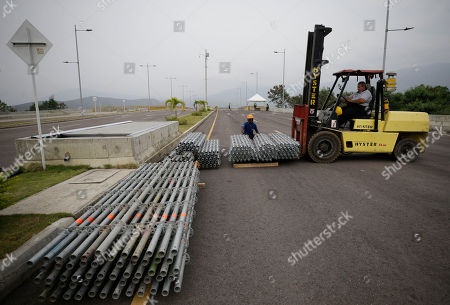 """Workers begin to build the stage for an upcoming concert coined: """"Concert for the freedom of Venezuela"""" on the Colombian side of the Tienditas International Bridge on the outskirts of Cucuta, Colombia, on the border with Venezuela, . Billionaire Richard Branson is organizing the concert on Feb. 22 featuring Spanish-French singer Manu Chao, Mexican band Mana, Spanish singer-songwriter Alejandro Sanz and Dominican artist Juan Luis Guerra"""