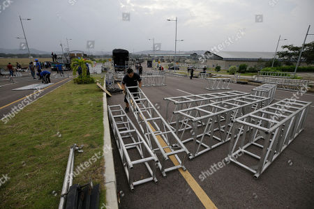 """Workers build the stage for an upcoming concert coined: """"Concert for the freedom of Venezuela"""" on the Colombian side of the Tienditas International Bridge on the outskirts of Cucuta, Colombia, on the border with Venezuela, . Billionaire Richard Branson is organizing the concert to rally humanitarian aid for Venezuela on Feb. 22, featuring Spanish-French singer Manu Chao, Mexican band Mana, Spanish singer-songwriter Alejandro Sanz and Dominican artist Juan Luis Guerra"""