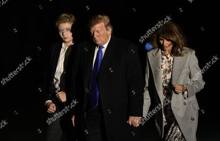 US President Donald J. Trump (C), first lady Melania Trump (R) and Barron Trump (L) arrive back at the White House in Washington, DC, USA, 18 February 2019.