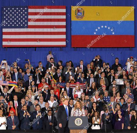Donald Trump, Melania Trump. First lady Melania Trump, right accompanied by President Donald Trump, speaks to a Venezuelan American community at Florida International University in Miami