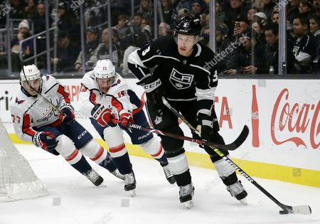 Dion Phaneuf, Jakub Vrana. Los Angeles Kings' Dion Phaneuf (3) controls the puck in front of Washington Capitals' Jakub Vrana (13) during the first period of an NHL hockey game, in Los Angeles