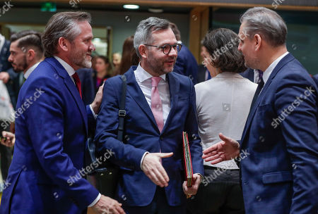 Denmark's Foreign Minister Anders Samuelsen (L) watches German Minister of State for Europe Michael Roth (L) greeting Hungarian Minister of State for EU Policies Szabolcs Takacs (R) prior to the EU General Affairs Council meeting in Brussels, Belgium, 19 February 2019. The Ministers will hold a policy debate on the multiannual financial framework for 2021-2027, the annotated draft agenda of the upcoming European Council in March, and will review the status of the procedures under Article 7(1) TEU on the rule of law in Poland and on respect for the EU values in Hungary, according to the council's official agenda.