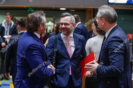 Denmark's Foreign Minister Anders Samuelsen (L) greets German Minister of State for Europe Michael Roth (L) with Hungarian Minister of State for EU Policies Szabolcs Takacs (R) looking on prior to the EU General Affairs Council meeting in Brussels, Belgium, 19 February 2019. The Ministers will hold a policy debate on the multiannual financial framework for 2021-2027, the annotated draft agenda of the upcoming European Council in March, and will review the status of the procedures under Article 7(1) TEU on the rule of law in Poland and on respect for the EU values in Hungary, according to the council's official agenda.