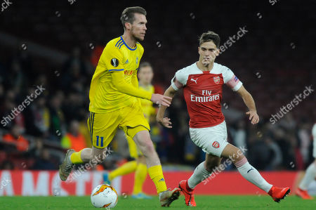 Stock Photo of Denis Suarez of Arsenal and Alexander Hleb of FC BATE Borisov in action during the UEFA Europa League round of 32 second leg match between Arsenal and FC BATE Borisov at Emirates Stadium in London, UK - 21st February 2019