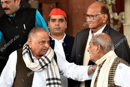 Samajwadi Party leader Mulayam Singh Yadav, MP Rewati Raman Singh as NCP leader Sharad Pawar