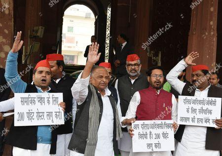 Samajwadi Party leaders Mulayam Singh Yadav, Dharmendra Yadav, leader Jai Prakash Narayan and other MPs stage a protest outside Parliament