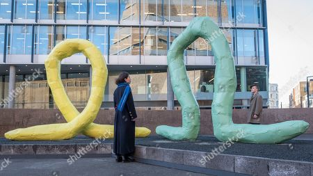 "Stock Photo of Gallery staff viewing (L to R) ""Alpha"", 2008, and ""Omega"", 2008, both by Franz West."