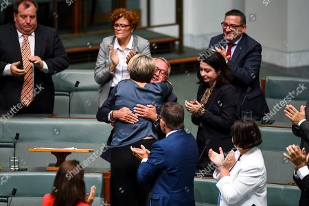Former Australian Treasurer Wayne Swan (C, back) is congratulated by the Deputy leader of the Opposition Tanya Plibersek after delivering his valedictory speech in the House of Representatives at Parliament House in Canberra, Australian Capital Territory, Australia, 19 February 2019.