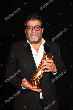 Stock Image of Alain Attal poses with the Daniel Tuscan du Plantier prize