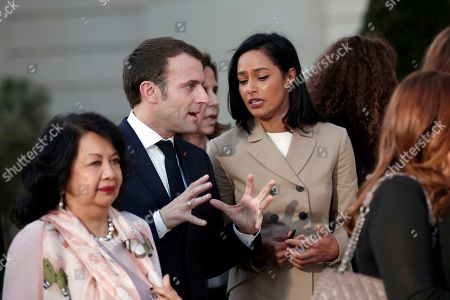 Stock Image of French President Emmanuel Macron (L) talks with Italian journalist Rula Jebreal (R) following a meeting for Gender Equality at the Elysee Palace, in Paris, France, 19 February 2019. This meeting takes place ahead of the next G7 summit in August 2019 in Biarritz, France.