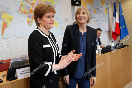 The First Minister of Scotland Nicola Sturgeon, left, arrives with French parliament member Marielle de Sarnez to discuss with members of foreign affairs commission of the French National Assembly, Tuesday, Feb.19, 2019 in Paris