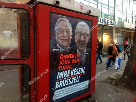 """A phone box displays a billboards showing Hungarian-American financier George Soros and EU Commission President Jean-Claude Juncker above the caption """"You have a right to know what Brussels is preparing to do!"""", on Vaci Avenue in Budapest, Hungary, . The Hungarian government has launched a new campaign targeting what it claims are efforts by the European Union leadership to organize mass migration into Europe, mainly by Muslims"""