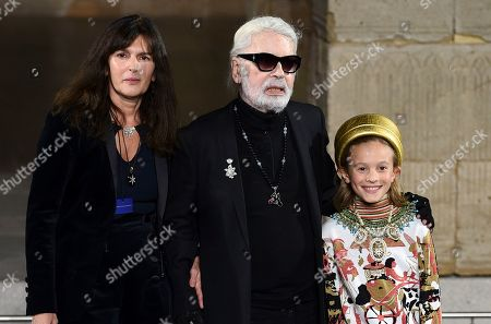 Karl Legerfeld, Hudson Kroenig. Fashion designer Karl Legerfeld, center, and godson Hudson Kroenig walk the runway during finale of the Chanel Metiers d'Art 2018/19 Show at the Metropolitan Museum of Art, in New York