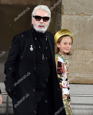 Karl Legerfeld, Hudson Kroenig. Fashion designer Karl Legerfeld and godson Hudson Kroenig during the finale of the Chanel Metiers d'Art 2018/19 Show at the Metropolitan Museum of Art, in New York
