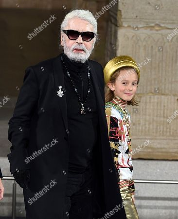 Karl Lagerfeld, Hudson Kroenig. Fashion designer Karl Lagerfeld and godson Hudson Kroenig during the finale of the Chanel Metiers d'Art 2018/19 Show at the Metropolitan Museum of Art, in New York