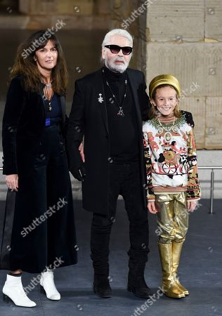 Stock Photo of Virginie Viard, Karl Lagerfeld, Hudson Kroenig. Fashion designer Karl Lagerfeld, center, walks with Chanel's fashion creation studio director Virginie Viard and his godson Hudson Kroenig during the finale of the Chanel Metiers d'Art 2018/19 Show at the Metropolitan Museum of Art, in New York
