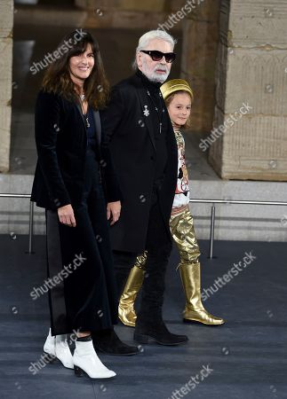 Stock Image of Virginie Viard, Karl Lagerfeld, Hudson Kroenig. Fashion designer Karl Lagerfeld, center, walks with Chanel's fashion creation studio director Virginie Viard and his godson Hudson Kroenig during the finale of the Chanel Metiers d'Art 2018/19 Show at the Metropolitan Museum of Art, in New York