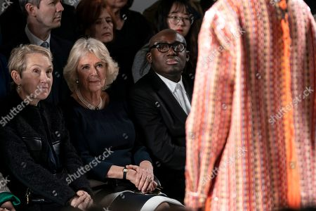 Britain's Camila, Duchess of Cornwall (C), Edward Enninful, Editor of Vogue UK (R) and Justine Picardie (L) watch a Bethany Williams show during London Fashion Week 2019, in Central London, Britain, 19 February 2019. The LFW Fall/Winter 2019 runs from 15 to 19 February.