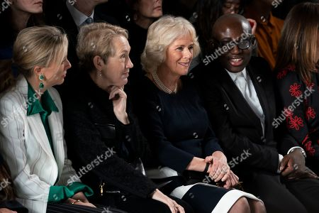 Britain's Camila, Duchess of Cornwall (C), Edward Enninful, Editor of Vogue UK (R) and Justine Picardie (2-L) watch a Bethany Williams show during London Fashion Week 2019, in Central London, Britain, 19 February 2019. The LFW Fall/Winter 2019 runs from 15 to 19 February.