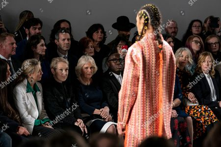 Britain's Camila, Duchess of Cornwall (C), Edward Enninful, Editor of Vogue UK (C-R) and Justine Picardie (C-L) watch a Bethany Williams show during London Fashion Week 2019, in Central London, Britain, 19 February 2019. The LFW Fall/Winter 2019 runs from 15 to 19 February.