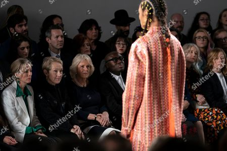 Britain's Camila, Duchess of Cornwall (C), Edward Enninful, Editor of Vogue UK (C-R) and Justine Picardie (2-L) watch a Bethany Williams show during London Fashion Week 2019, in Central London, Britain, 19 February 2019. The LFW Fall/Winter 2019 runs from 15 to 19 February.