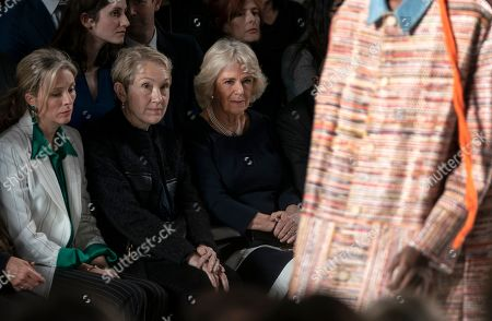 Britain's Camila, Duchess of Cornwall (R) and Justine Picardie (C) watch a Bethany Williams show during London Fashion Week 2019, in Central London, Britain, 19 February 2019. The LFW Fall/Winter 2019 runs from 15 to 19 February.