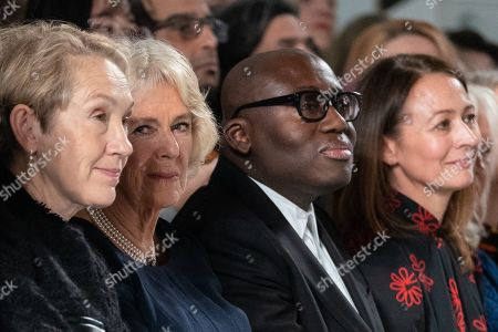 (L-R) Editor-in-chief of Harper's Bazaar UK Justine Picardie, Britain's Camilla, Duchess of Cornwall, editor-in-chief of British Vogue magazine Edward Enninful and Chief Executive of the British Fashion Council Caroline Rush sit on the front row to watch a runway show of creations by Bethany Williams during London Fashion Week 2019, in Central London, Britain, 19 February 2019. The LFW Fall/Winter 2019 runs from 15 to 19 February.