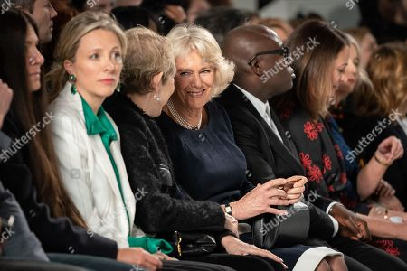 Britain's Camilla, Duchess of Cornwall (C) sits on the front row between editor-in-chief of Harper's Bazaar UK Justine Picardie (C-L) and editor-in-chief of British Vogue magazine Edward Enninful (C-R) to watch a runway show of creations by Bethany Williams during London Fashion Week 2019, in Central London, Britain, 19 February 2019. The LFW Fall/Winter 2019 runs from 15 to 19 February.