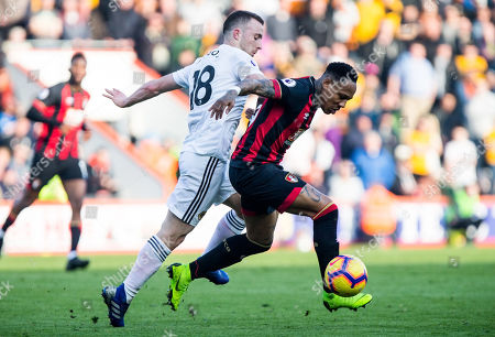 Nathaniel Clyne of Bournemouth is tracked by Diogo Jota of Wolverhampton Wanderers