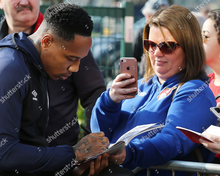 Stock Image of Nathaniel Clyne of Bournemouth signs an autograph for a fan prior to