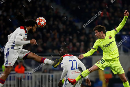 Lyon's Lyon's Jason Denayer ((L) in action  against FC Barcelona's Sergi Roberto (R) during the UEFA Champions League round of 16 first leg soccer match between Olympique Lyonnais and FC Barcelona at the Groupama Stadium in Decines-Charpieu, near Lyon, France, on 19 February 2019.