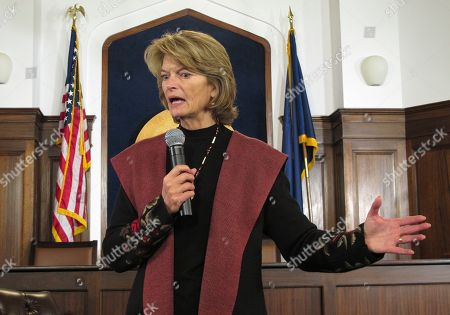 U.S. Sen. Lisa Murkowski speaks to reporters after delivering a speech to a joint session of the Alaska Legislature, in Juneau, Alaska. During the news conference, the Alaska Republican expressed concerns with President Donald Trump's declaration of a national emergency to secure more money for a wall on the U.S.-Mexico border
