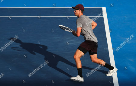 Peter Polansky, of Canada, in action against John Isner, of the United States, during the first round of the Delray Beach Open ATP professional tennis tournament, played at the Delray Beach Stadium & Tennis Center in Delray Beach, Florida, USA