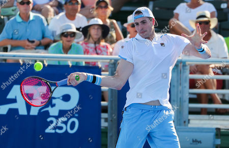 John Isner, of the United States, hits a forehand against Peter Polansky, of Canada, during the first round of the Delray Beach Open ATP professional tennis tournament, played at the Delray Beach Stadium & Tennis Center in Delray Beach, Florida, USA