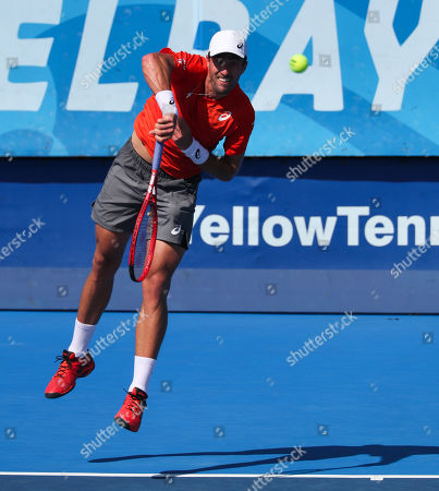 Steve Johnson, of the United States, serves against Jason Jung, of Taipei, during the first round of the Delray Beach Open ATP professional tennis tournament, played at the Delray Beach Stadium & Tennis Center in Delray Beach, Florida, USA