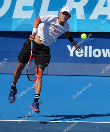 Stock Picture of Jason Jung, of Taipei, serves against Steve Johnson, of the United States, during the first round of the Delray Beach Open ATP professional tennis tournament, played at the Delray Beach Stadium & Tennis Center in Delray Beach, Florida, USA