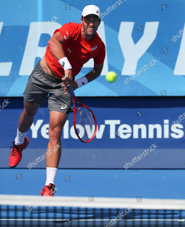 Stock Image of Steve Johnson, of the United States, serves against Jason Jung, of Taipei, during the first round of the Delray Beach Open ATP professional tennis tournament, played at the Delray Beach Stadium & Tennis Center in Delray Beach, Florida, USA