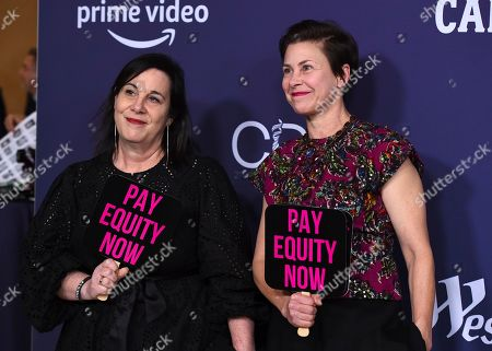 """Stock Photo of Arianne Phillips, Nancy Steiner. Costume designers Arianne Phillips, left, and Nancy Steiner carry signs that read """"Pay Equity Now"""" as they arrive at the 21st annual Costume Designers Guild Awards at The Beverly Hilton Hotel, in Beverly Hills, Calif"""
