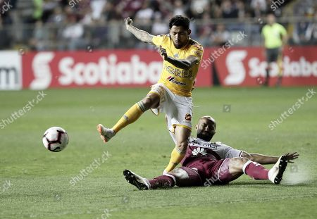 Ricardo Blanco (R) of Deportivo Saprissa in action against Javier Aquino (L) of Tigres UANL during the CONCACAF Champions League soccer match between Deportivo Saprissa of Costa Rica and Tigres UANL of Mexico, in San Jose, Costa Rica, 19 February 2019.