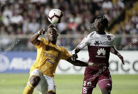 Aubrey David (R) of Deportivo Saprissa in action against Julian Quinones (L) of Tigres UANL during the CONCACAF Champions League soccer match between Deportivo Saprissa of Costa Rica and Tigres UANL of Mexico, in San Jose, Costa Rica, 19 February 2019.