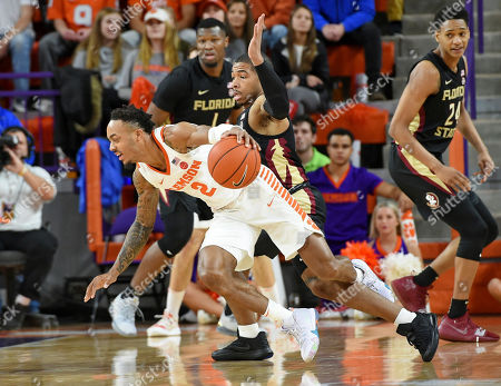 Clemson's Marcquise Reed,left, is fouled by Florida State's David Nichols, right, during the first half of an NCAA college basketball game, in Clemson, S.C
