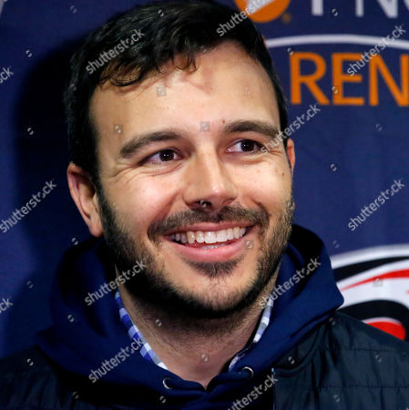 Charlie Ebersol, co-founder and CEO of the Alliance of American Football, talks to the media about Carolina Hurricanes majority owner Tom Dundon's $250 million investment in the league before the start of an NHL hockey game between the New York Rangers and the Carolina Hurricanes in Raleigh, N.C., . Dundon was also at the press conference