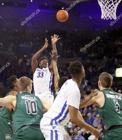Buffalo Bulls forward Nick Perkins (33) shoots a three during the first half of play in the NCAA Basketball game between the Ohio Bobcats and Buffalo Bulls at Alumni Arena in Amherst, N.Y. (Nicholas T