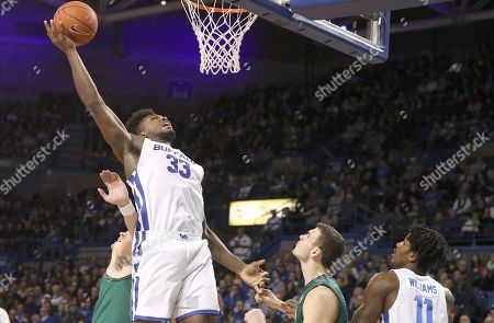 Buffalo Bulls forward Nick Perkins (33) tips a rebound to the basket for a first half basket in the NCAA Basketball game between the Ohio Bobcats and Buffalo Bulls at Alumni Arena in Amherst, N.Y. (Nicholas T