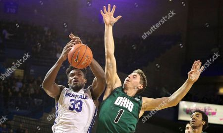 Buffalo Bulls forward Nick Perkins (33) battles with Ohio Bobcats forward Jason Carter (1) for a rebound during the second half of play in the NCAA Basketball game between the Ohio Bobcats and Buffalo Bulls at Alumni Arena in Amherst, N.Y. (Nicholas T