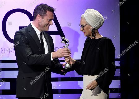 "Jason O'Mara, Lou Eyrich. Jason O'Mara, left, presents the award for excellence in contemporary television to Lou Eyrich for ""The Assassination of Gianni Versace: American Crime Story"" at the 21st annual Costume Designers Guild Awards at The Beverly Hilton Hotel, in Beverly Hills, Calif"