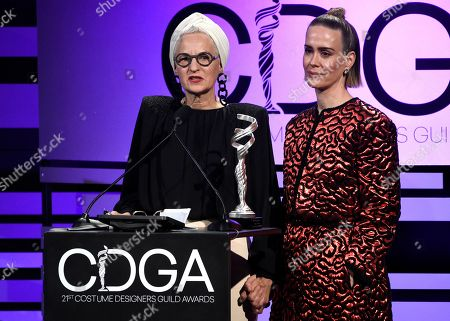 Lou Eyrich, Sarah Paulson. Lou Eyrich, left, and Sarah Paulson present the distinguished collaborator award at the 21st annual Costume Designers Guild Awards at The Beverly Hilton Hotel, in Beverly Hills, Calif