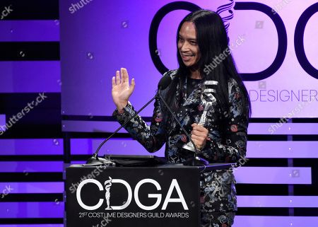 "Zaldy Goco accepts the excellence in variety, reality-competition, live television award for ""RuPaul's Drag Race"" at the 21st annual Costume Designers Guild Awards at The Beverly Hilton Hotel, in Beverly Hills, Calif"